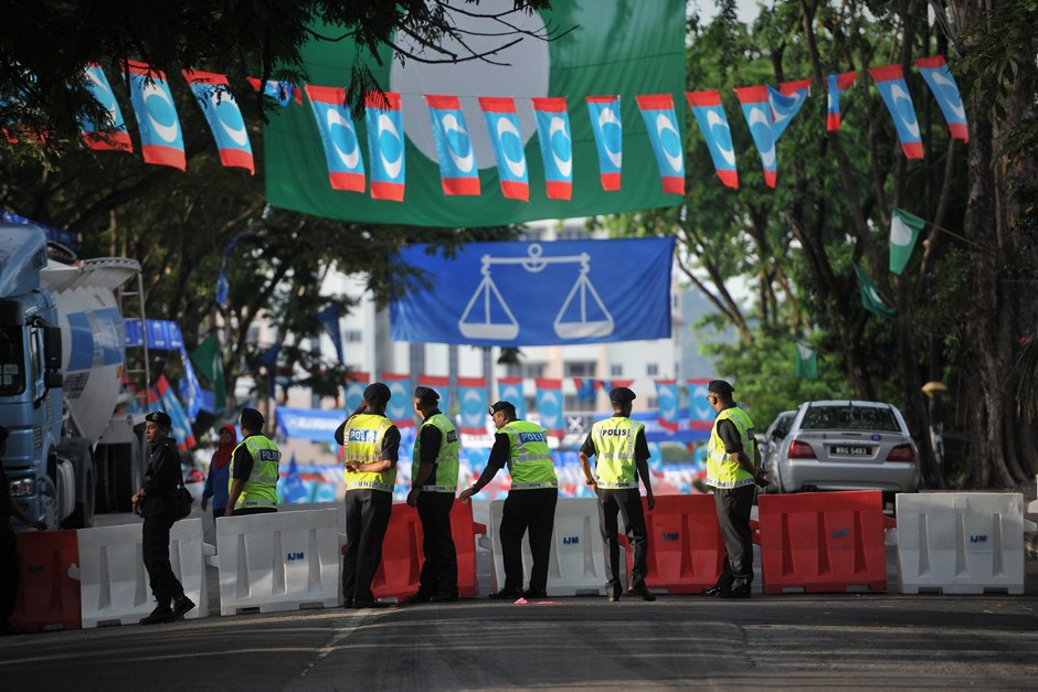 A police officer during nomination day for Malaysia General Election on May 5 elections in Kuala Lumpur April 20 2013.