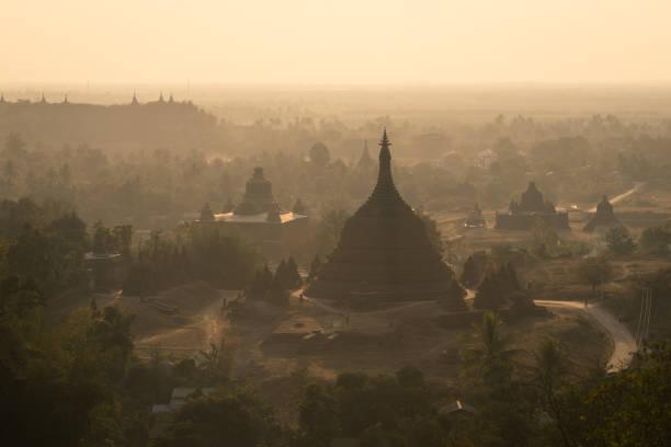 Pagodas and monastery on hill at sunset, north Mrauk U, Rakhine state, Myanmar , Asia