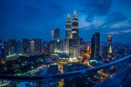 42414469-kuala-lumpur-twin-towers-at-night-high-angle-and-fish-eye-view